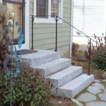 Steel railing on new granite steps