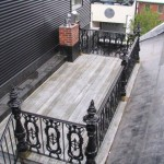 A City Roof Deck with Cast Iron Railing