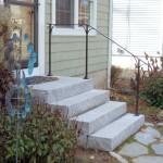 Steel railing on new granite steps