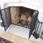 Fireplace with figural andirons, tools